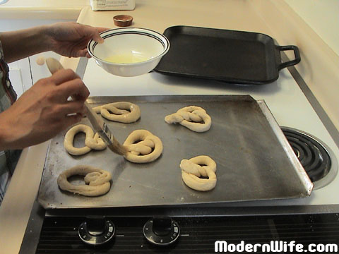Brushing Pretzels with egg white glaze