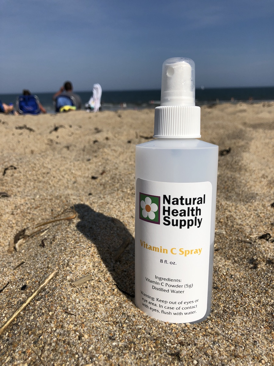 Vitamin C Spray for sun protection at the beach